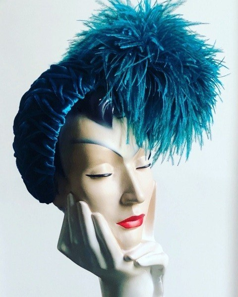 turquoise-with-feather-pompom